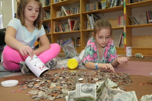 IMG_1117 Abigail Gagnon 6 1gr and Brooklyn Jordan 6 1gr are from Reid Elem are counting the money they raise for dines for diapers. March 29 17