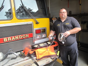 Brandon Township Fire Department Capt. Billy Starr with the rapid intervention kit.