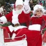 IMG_0002 Santa Claus and Mrs. Claus  waves to the people long the parade at the Christmas in the Village in  Ortonville Dec 3 16