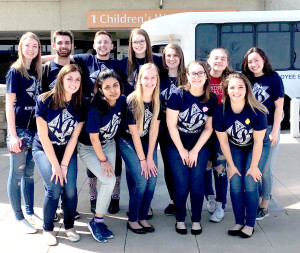 Megan Duval, back row on far left, with Saginaw Valley State University students at Arkansas Children's Hospital. Duval is a 2016 Goodrich High School graduate.