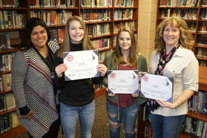 From left, Michelle Molina, agent Farm Bureau Insurance Clarkston; Ella Locey, first place; Miaya Tait, second place and Dawn Robb, English, Language Arts teacher at BMS for Taylor Thomas, third place winner. Photo by Patrick McAbee.