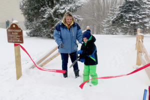 Wendy Ciaramitaro, Village Parks & Recreation chairwoman and Camden Swartz, Reid student who named the park cuts ribbon on Saturday. Photo by Patrick McAbee.